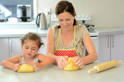 Mother and child kneading dough Stock Photography