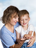 Mother, child and ladybird Stock Photography