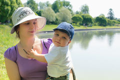Mother and child by lake Stock Image