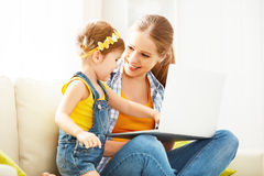 Mother and child with  laptop computer Royalty Free Stock Photo