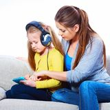 Mother with child learning home work. With tab pc Royalty Free Stock Photo