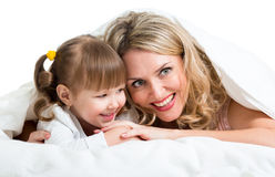 Mother and child lie in the bed Stock Photography