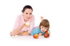 Mother with a child lies and eat apples Stock Image