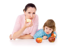 Mother with a child lies and eat apples Royalty Free Stock Photos