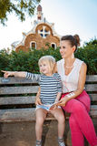 Mother and child listening audioguide and pointing on something Royalty Free Stock Photo