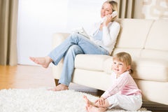 Mother and child in living room watch television Royalty Free Stock Images