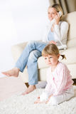 Mother and child in living room watch television Stock Photo