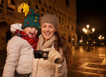 Mother and child looking on photos on Piazza San Marco in Venice Royalty Free Stock Photo