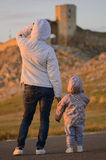 Mother and child looking at Ruins of Ancient city on sunset Royalty Free Stock Photography