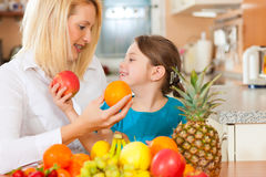 Mother and child with lots of fruits Royalty Free Stock Photo