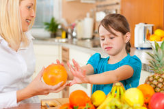 Mother and child with lots of fruits royalty free stock photos