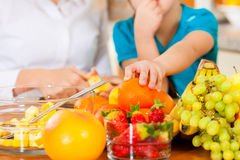 Mother and child with lots of fruits stock photos