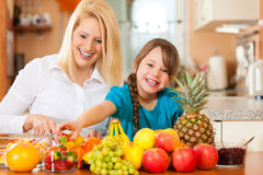 Mother and child with lots of fruits stock photo