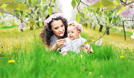 Mother and child lying on the fresh lawn Royalty Free Stock Image