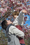 Mother and child and magnolia flowers Royalty Free Stock Photos