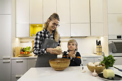 Mother and child making dough for pizza Stock Images