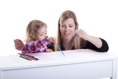 Mother and child making a drawing Royalty Free Stock Photos