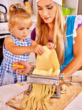Mother and child making homemade pasta Stock Photo