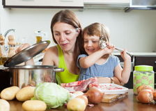 Woman With Child Making Soup Stock Photo - Image: 39855269