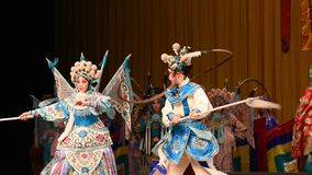 """The mother and child in the martial arts competition- Beijing Opera"""" Women Generals of Yang Family"""" stock video footage"""