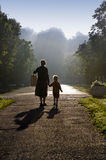 Mother and Child in the Misty Morning Sun Stock Photos