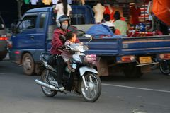 Mother and child, transport on a motorbike, Vientiane,Laos Royalty Free Stock Photography