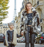Mother and child nearby Eiffel tower in Paris, France walking Royalty Free Stock Photos