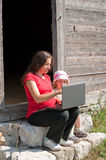 Mother and child oudoors with a laptop Royalty Free Stock Photos