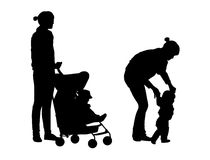 Mother and child outdoor silhouettes set. Set of two silhouettes of young mother and her little baby outdoor, with a baby buggy and walking together hand in hand Royalty Free Stock Photography