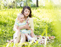 Mother with child outdoors Royalty Free Stock Image