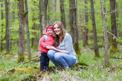 Mother and child outdoors playing, kissing and hugging Royalty Free Stock Photography