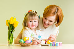 Mother and child paint easter eggs. Mother and daughter kid painting easter eggs Royalty Free Stock Photos