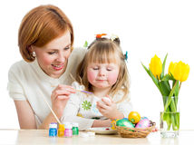 Mother and child paint easter eggs. Mother and baby kid painting easter eggs isolated Royalty Free Stock Photos