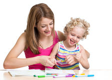 Mother and child paint together Stock Photos