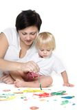 Mother and child painting over white Royalty Free Stock Images