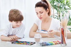 Mother with child painting Stock Photo