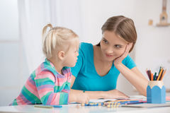 Mother and Child Parenting Motherhood Love Care Concept. Mother young women sitting with her child drawing stock image