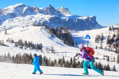 Mother child photographs on the slopes at the ski resort Royalty Free Stock Photography