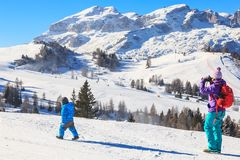 Mother child photographs on the slopes at the ski resort Royalty Free Stock Photos