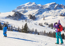 Mother child photographs on the slopes at the ski resort Royalty Free Stock Image