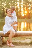 Mother and child play in autumn park Stock Photos