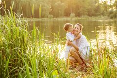 Mother and child play in autumn park Stock Image