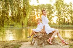 Mother and child play in autumn park Royalty Free Stock Image