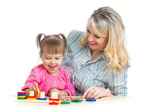 Mother and child play with colorful puzzle toy Stock Photo
