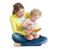 Mother and child play musical toy Royalty Free Stock Photo