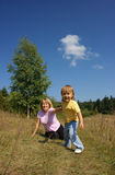 Mother and child play outdoors Stock Image