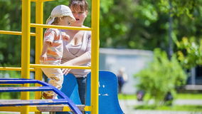 Mother And Child On the Playground Stock Photography