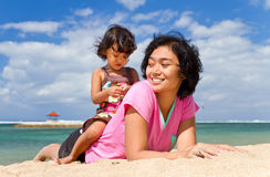 Mother and child playing at the beach Stock Photography