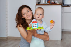 Mother and child playing and discovery. Mother and child  playing and discovery at a home interior Stock Photo