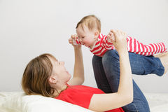 Mother and child playing at home Royalty Free Stock Photos